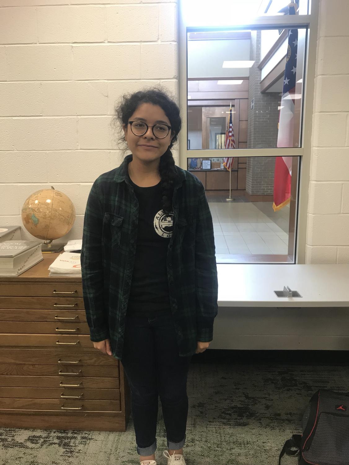 Junior, Margarita Delgado poses in her plaid flannel. Photo Credit: Natalie Navarra