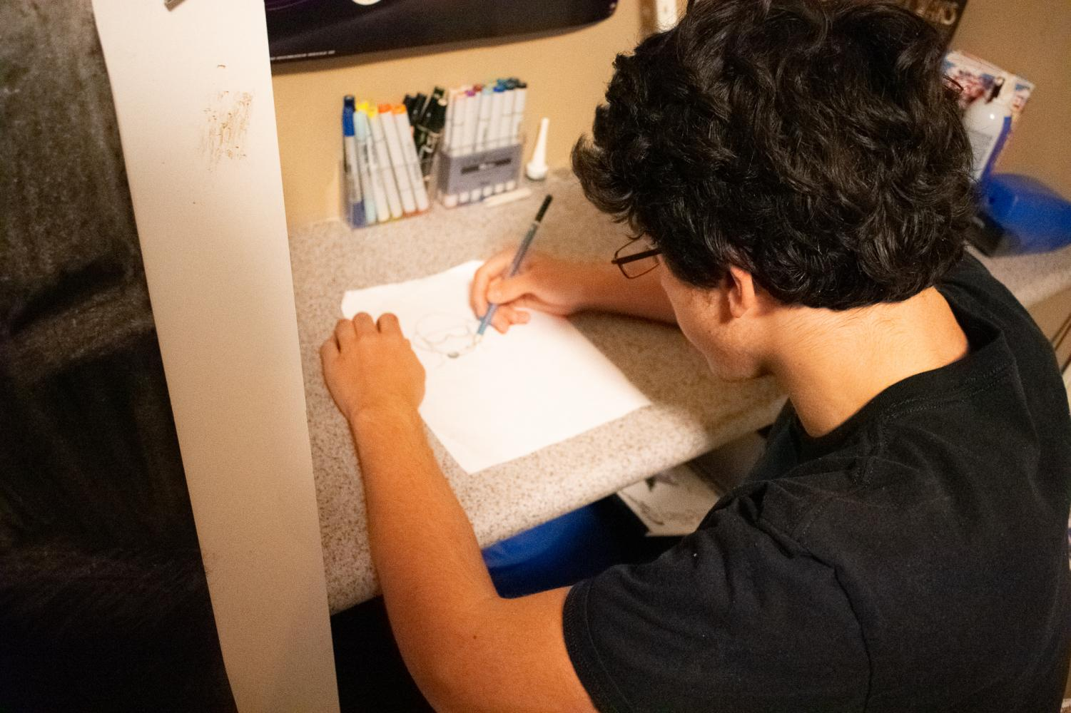 Brandon Komesar working on his latest art project, photographed by Sahba Ostovar, Dec. 9, 2018
