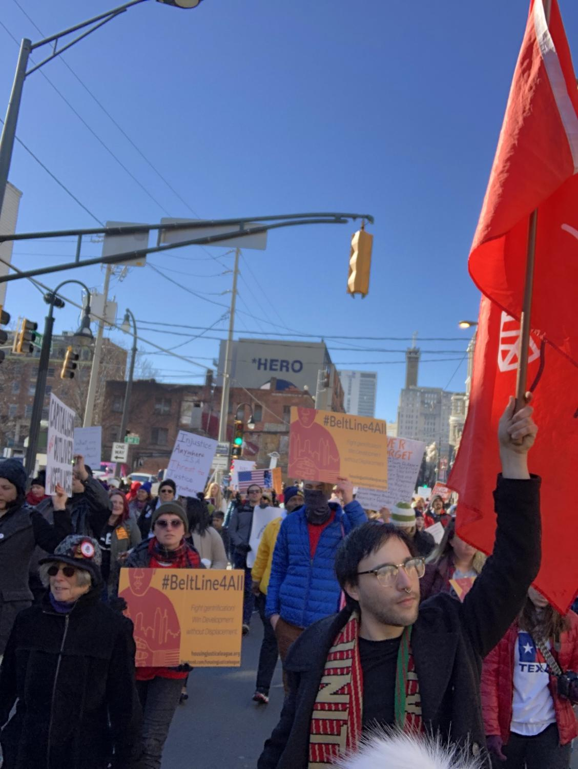 Hundreds gathered in downtown Atlanta for the Martin Luther King Jr. day parade, in which the state of our government and it's possibility of another shutdown was widely discussed. |Photo Credit: Ava Weinreb