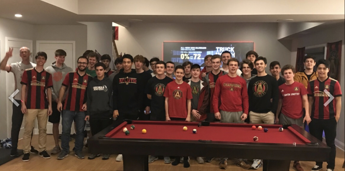 the boys are having a fun pasta dinner while watching Atlanta United!