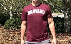 Trading in his green and black for Harvard crimson