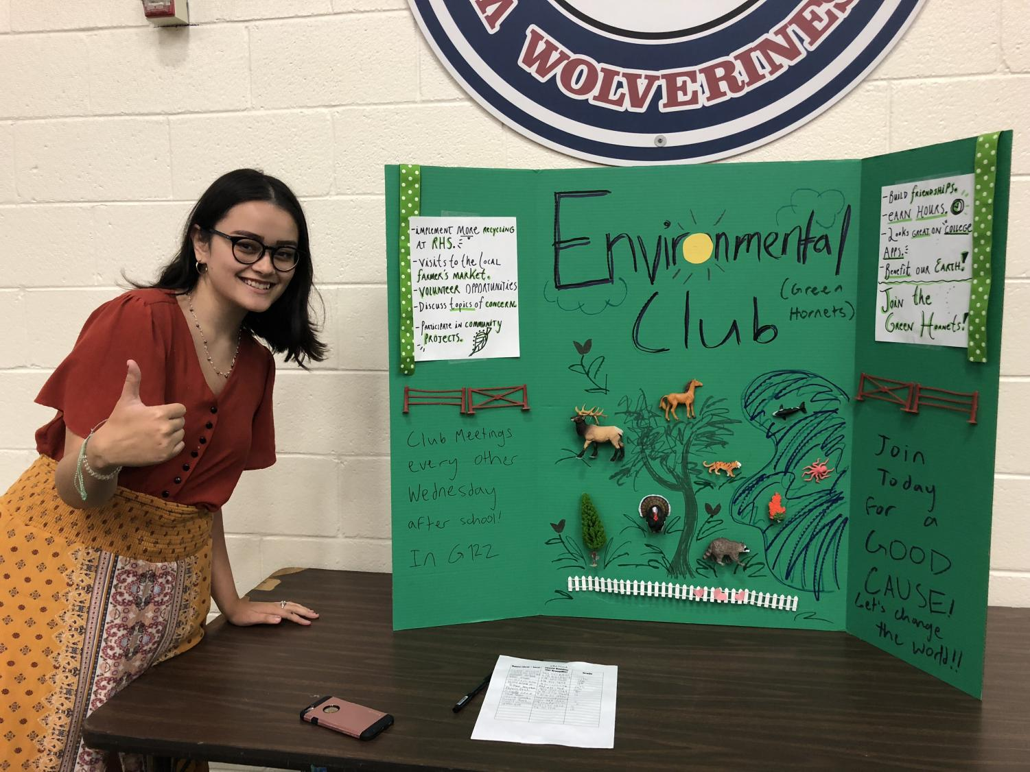 Senior Elisa Offer attracts new members at the Club Fair for the Environmental Club. Photo Credit: Smriti Tayal