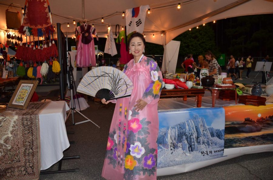 Dressed+in+an+authentic+Korean+dress%2C+this+beautiful+woman+posed+with+a+traditional+fan+for+the+picture.+She+was+sharing+her+Korean+culture+with+the+Night+Market+attendees.+Photo+Credit%3A+Smriti+Tayal