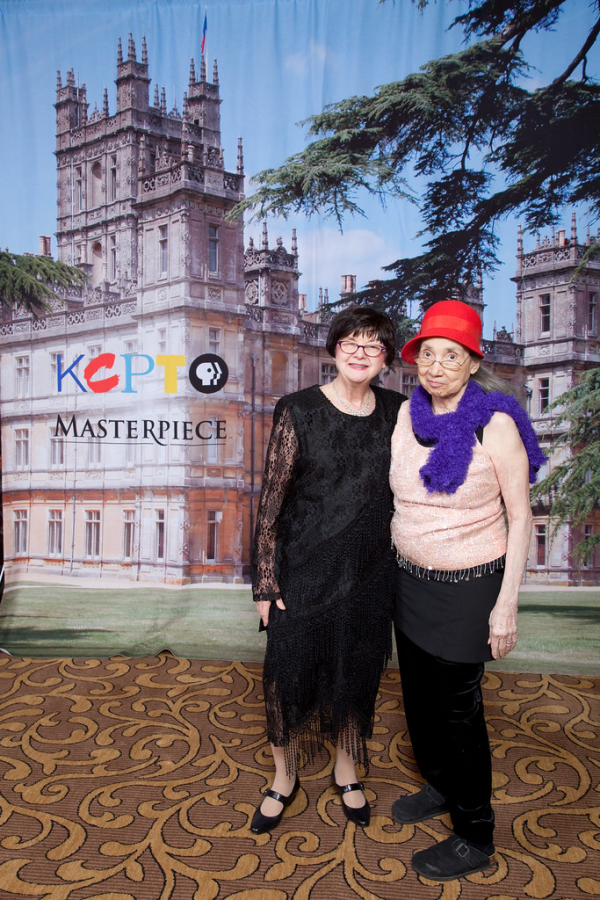 Downton lovers in front of a backdrop of the famed Crawley manor. Photo Credit: Creative Commons