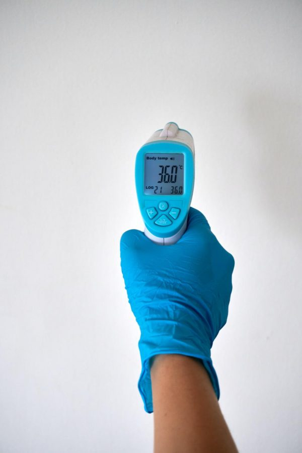 Digital temperature checking devices are the new norm when entering buildings, restaurants, and store. Photo Credit: Anton