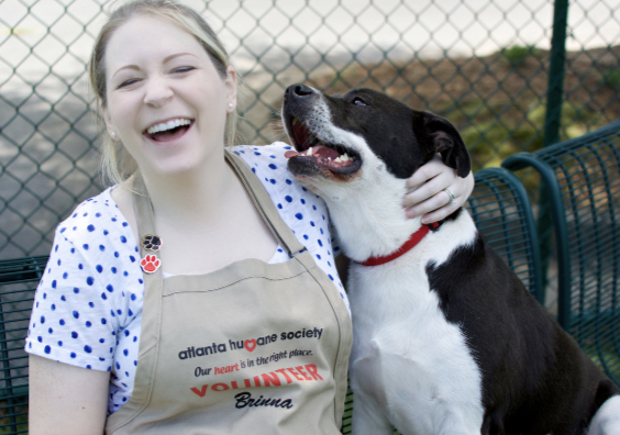 A volunteer at the Atlanta Humane Society, Brinna, spends time with a dog previously available for adoption at the shelter. credit:The Atlanta Humane Society