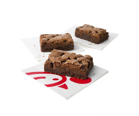 The new brownie at chick fil a has a creamy inside with chocolate fudge pieces within the yummy square.
