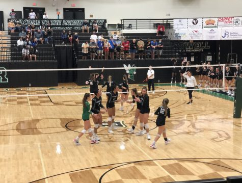The volleyball team huddled up after making a show stopping spike to take the lead in the third quarter. This allows the girls to collect themselves and game plan their next move. Photo credit - Katie Northenor