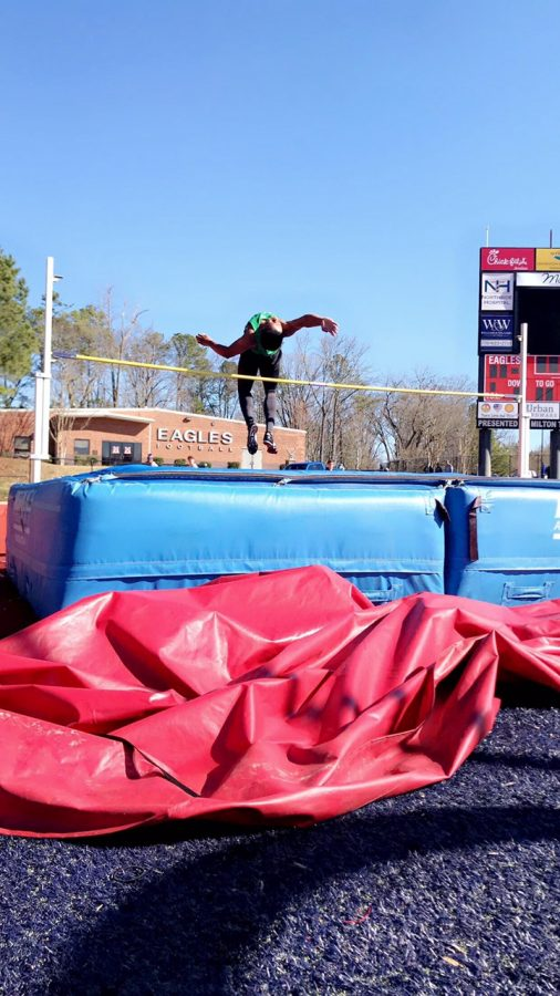 Eldridge Harris high jumping for RHS at a 2020 season meet at Milton High School. Photo Credit: Lauren Helsing