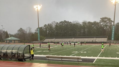The girls and boys varsity soccer teams scrimmage each other to prepare for their seasons. Photo Credit: Ashley Meyer