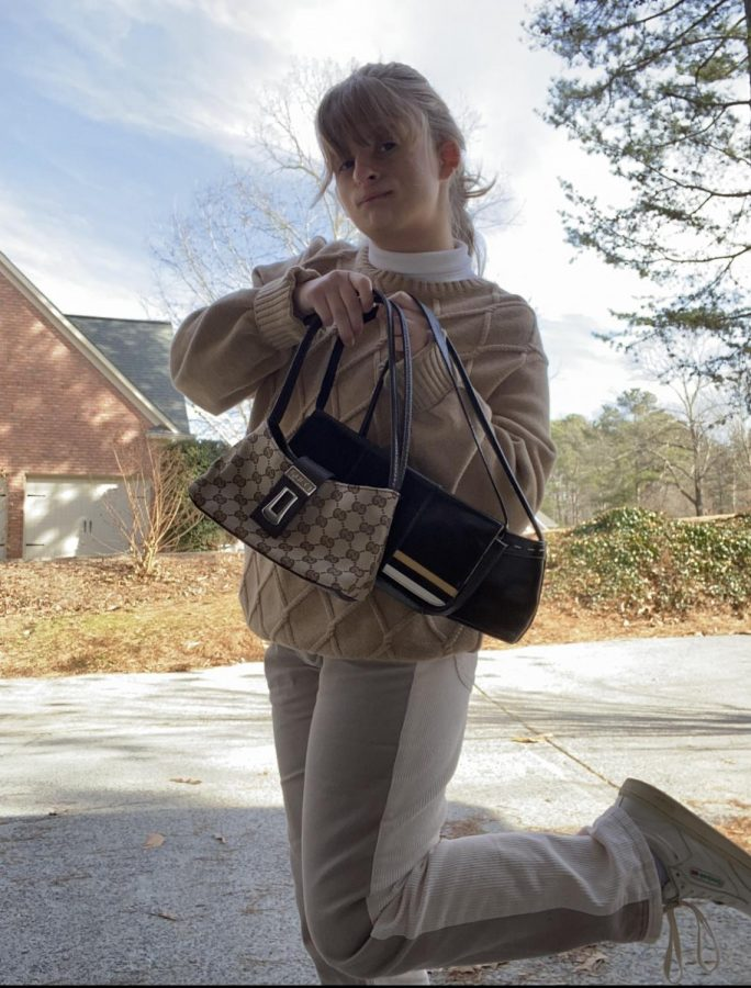 I have started a mini collection of shoulder bags purely because I love them so much. I have gotten each one from a thrift store or my mom's closet so don't think you need to spend a lot of money to join in on this trend. Photo credit: Rachel Sandstrom