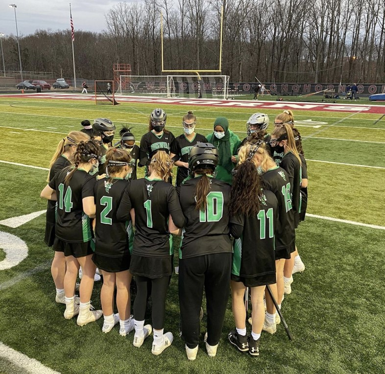 The varsity team gets together to do some pre-game rituals. Photo Credit: Roswell Girls lacrosse Instagram