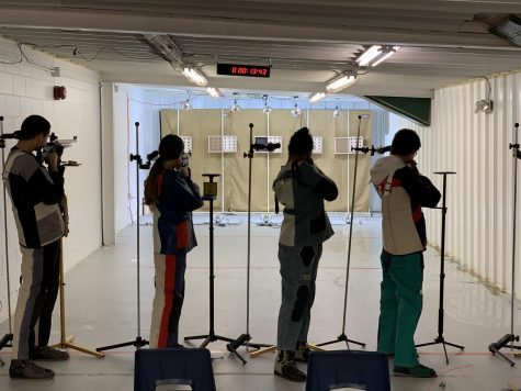 Members of the riflery team compete for first place. Photo Credit: Yuriy Soroka