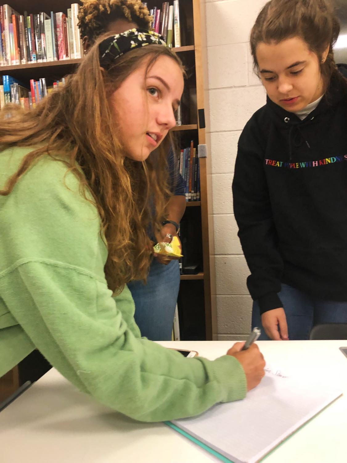 Student Council executive secretary Emma Guglielmo takes attendence at the last meeting before homecoming as they plan the last minute events for the dance on Saturday. Photo Credit: Smriti Tayal