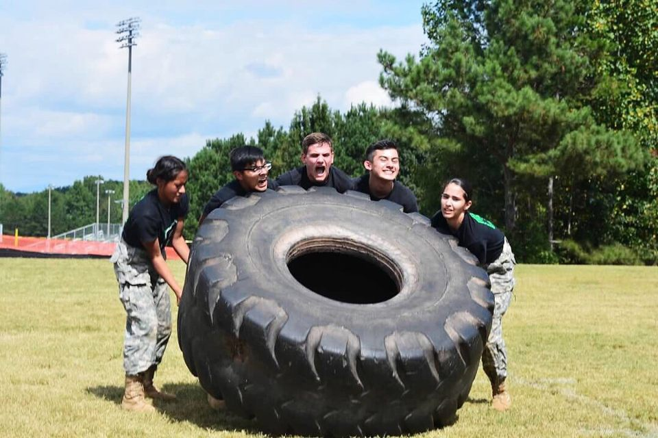 JROTC team practicing tire flipping| Photo: Jenna Keiser