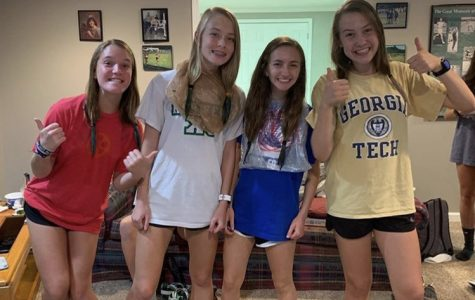Cross country girls get together and dye their hair green for pre-region meet bonding! Photo Credit: Lynley Blocker