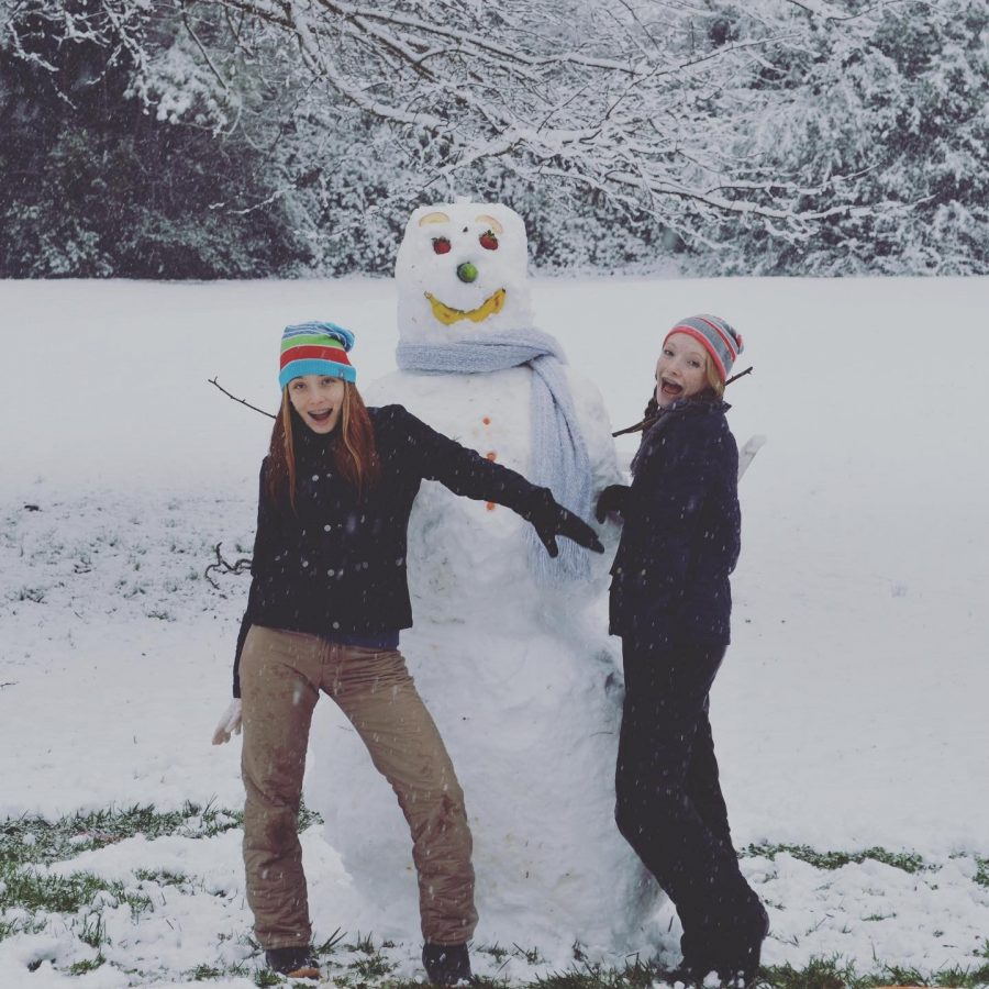 Ainsley and Gabby Gillespie pose with the snowman they made. Photo Credit: Claire Mulkey