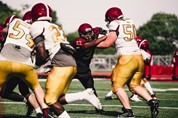 Two football teams playing a game makes it hard to social distance on the field.  Photo credit: Alora Griffiths on Unsplash