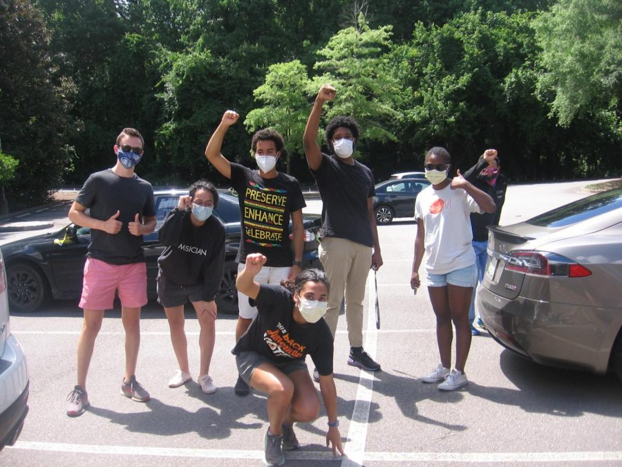 Roswell students participating in a caravan protest on canton street this summer. Students include seniors Erin Lanier, Rajath Prabhakar, and April McBride. Photo Credit: April McBride
