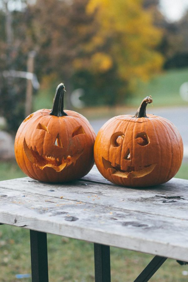 These two carved pumpkins encapsulate the creativity and fun that is exclusive to the fall season. credits: unsplash