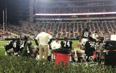 The Dawgs offensive line huddled up on the sidelines talking out there next play against Mississippi State. Photo credit: Drew Maddox