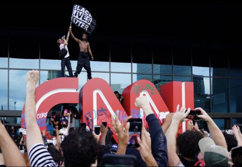 Protestors in Atlanta climbed on CNN sign in the front of network headquarters on Friday May, 29th. Credit: Ben Gray/ Atlanta Journal-Constitution