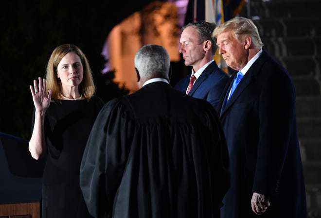 Amy Coney Barrett gets sworn in by Justice Clarence Thomas, cementing an extreme conservative court for years to come. Photo Credit: CNN