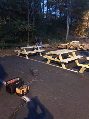 The volunteers make quick work at building the picnic tables so students are able to have more space to eat outside in the future.