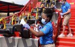 Workers at Six Flags over Georgia clean down rides and always keep a mask on due to Covid-19 regulations. Photo credit: Fox 5 Atlanta