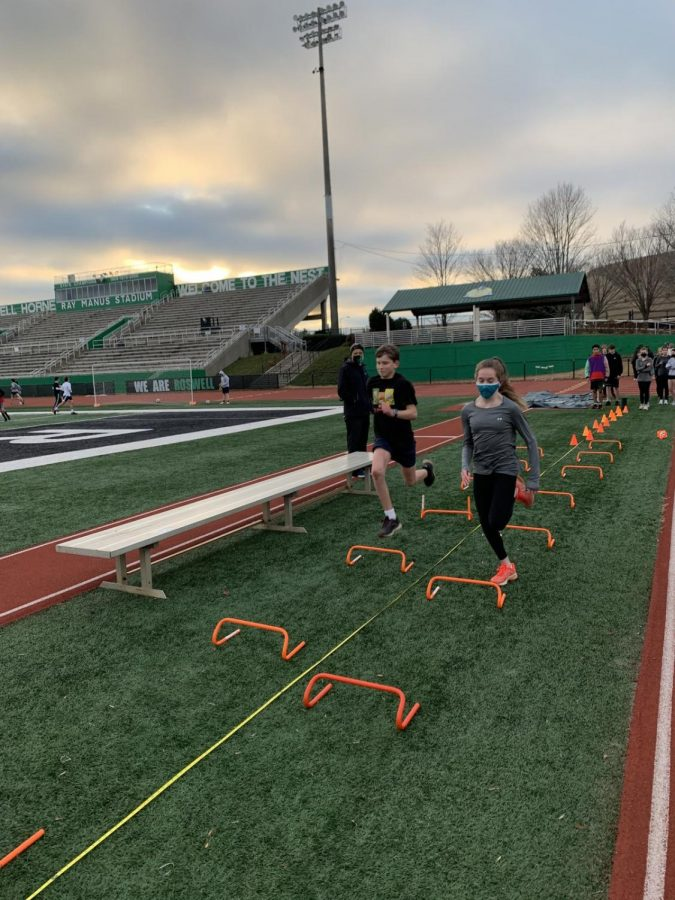 Wickets are a favorite of cross country and track athletes. They are great speed builders and a fun conclusion to practice. (Runners wear masks at all times, except when running, although some choose to keep theirs even while running.)