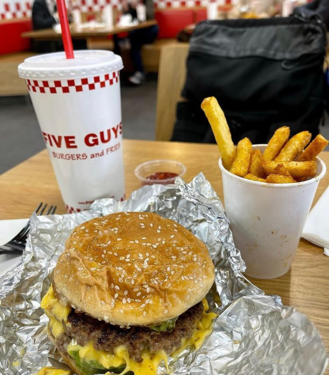 - A classic burger from Five Guys is $7.69 and worth every penny. Photo by Ashley Meyer