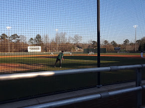 Presley Martinez  takes infield warmups before Roswell takes on North Springs. The Hornets beat the Spartans, 7-0.