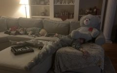 Freshman Kate Holloway taking an afternoon nap on the couch with her dog Echo. credit: Kate Holloway