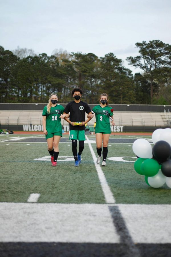 Adleigh Wheeler (junior), Keenan Williams(senior) and Julian Zamudio (junior) walking out together on Spirit Night Photo Credits: Sadie Zeigler