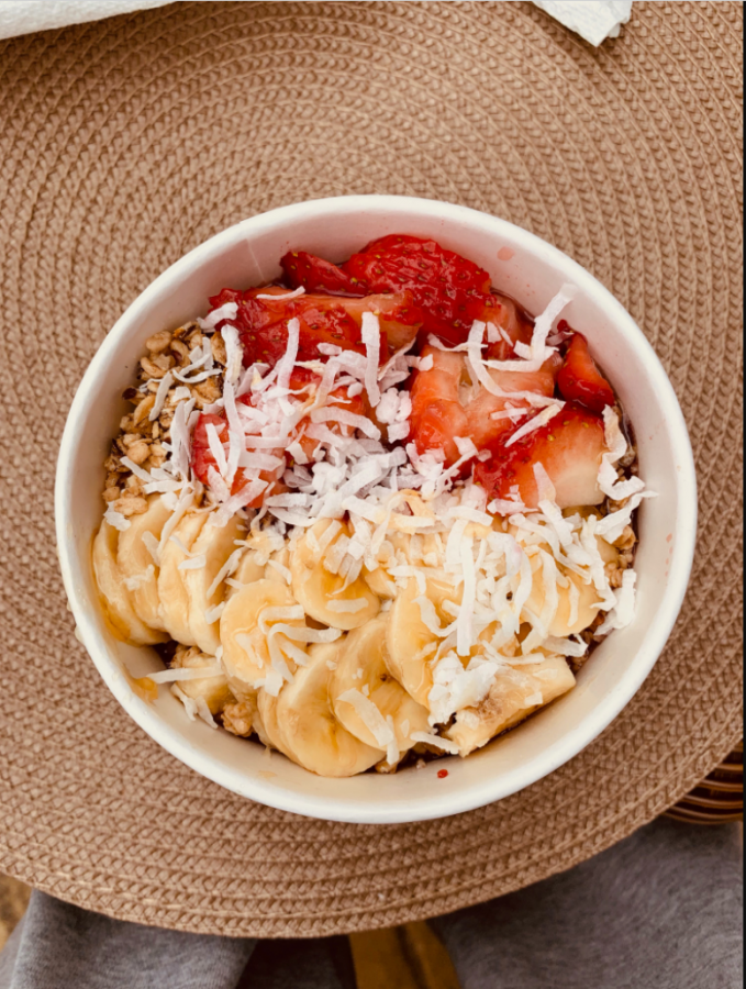 The vitality bowl pictured is made of a base blend of organic açai topped with organic granola, honey, bananas, strawberries, organic goji, and berries. (Credit: Katie Northenor)
