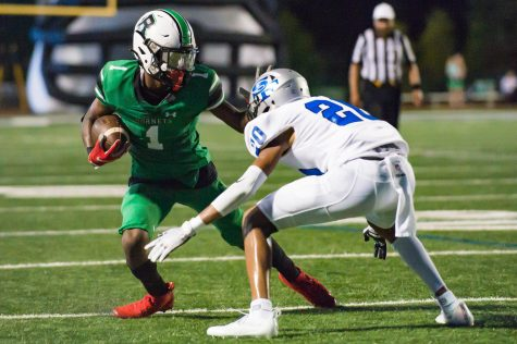 Roswell athlete Ethan Nation,11, avoiding a tackle against South Forsyth. Credit Will Fagan
