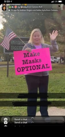Masker takes flags from 9/11 to help in their protest against mask mandates.